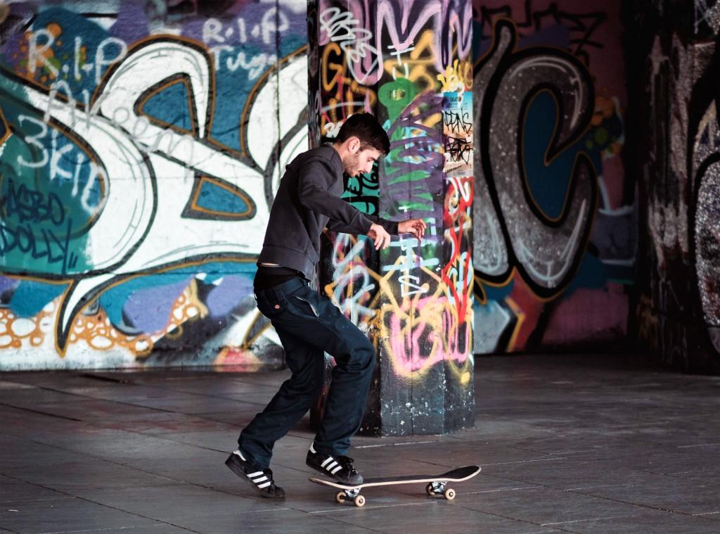 Grafitti-laden walls with skateboarder on London's Southbank, Photo Clem Onojeghuo / unsplash