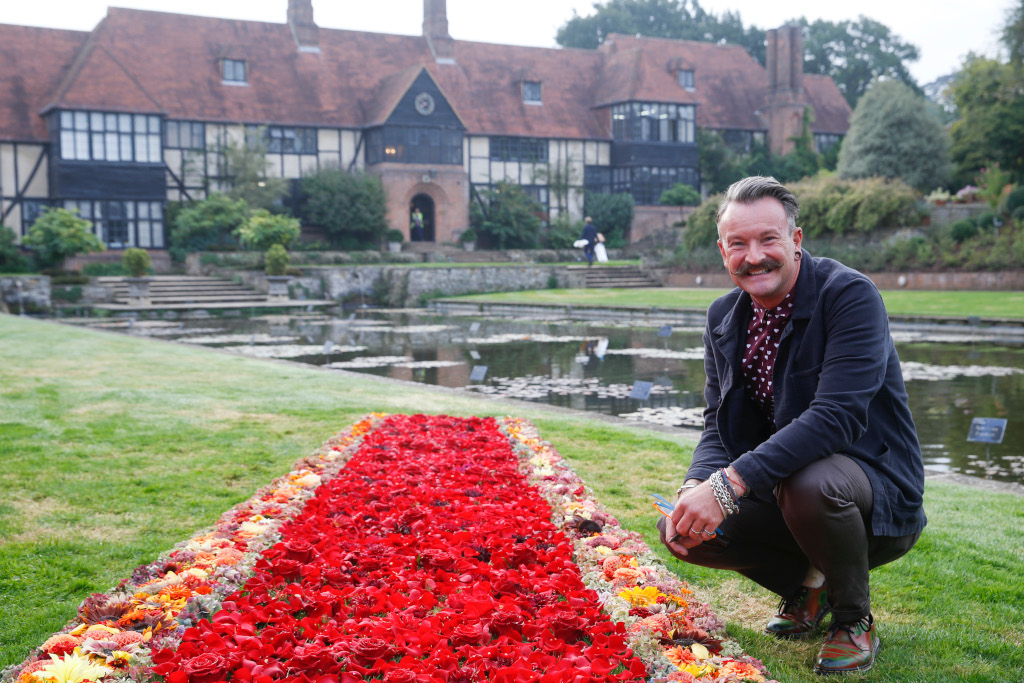 Floral designer Simon Lycett with his floral red carpet at RHS Garden Wisley Flower Show near Woking, Surrey, Tuesday September 4, 2018. The Hollywood style carpet was created by floral designer Simon Lycett and made of British grown locally sourced flowers. The show opens today and runs until September 9. RHS / Luke MacGregor