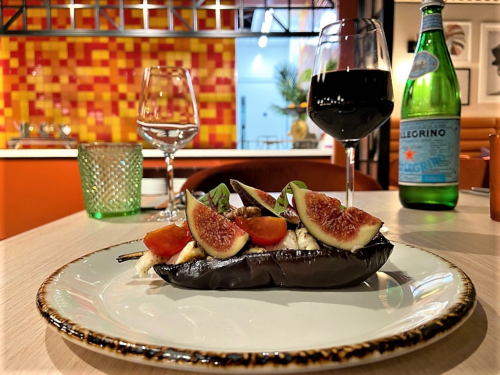 Harissa roasted aubergine dish served with goat's cheese