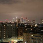 Canary Wharf appearing from the night sky